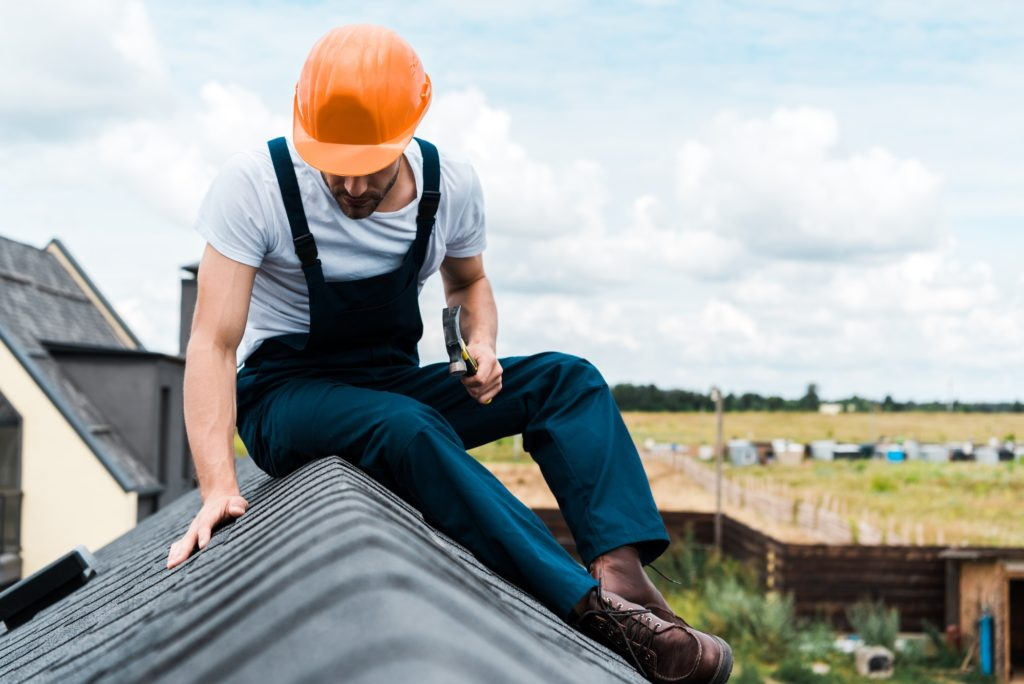 sitting on roof and repairing roof